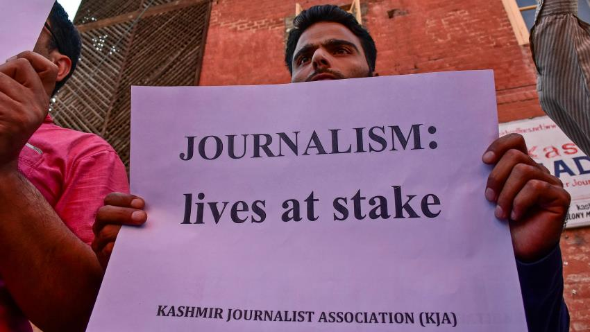 Pic 2 A journalist holding a poster during protest in Srinagar.